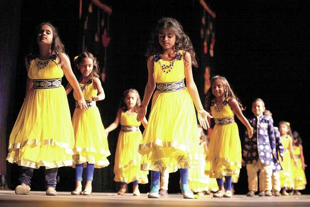 "Young children dance to ""Jabra"" choreographed by Alka Kumar during Diwali Cultural Night 2016 at the Midland County Horseshoe Pavilion."