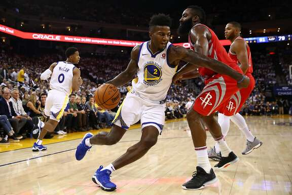 OAKLAND, CA - OCTOBER 17:  Jordan Bell #2 of the Golden State Warriors drives to the hoop against James Harden #13 of the Houston Rockets during their NBA game at ORACLE Arena on October 17, 2017 in Oakland, California. NOTE TO USER: User expressly acknowledges and agrees that, by downloading and or using this photograph, User is consenting to the terms and conditions of the Getty Images License Agreement.  (Photo by Ezra Shaw/Getty Images)