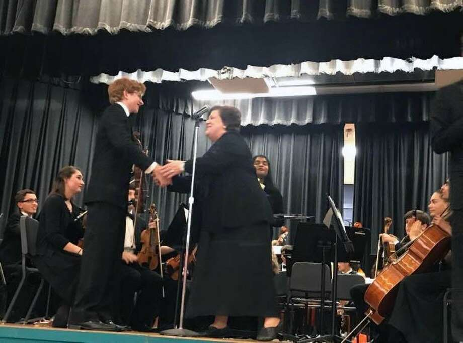 "Staples music teacher Adele Valovich congratulates Jack Whitten after he completed the violin solo on Mozart's ""Symphonie Concertante"" on Oct. 18 at the Staples String Concert in Westport. Photo: Contributed Photo / Westport News contributed"