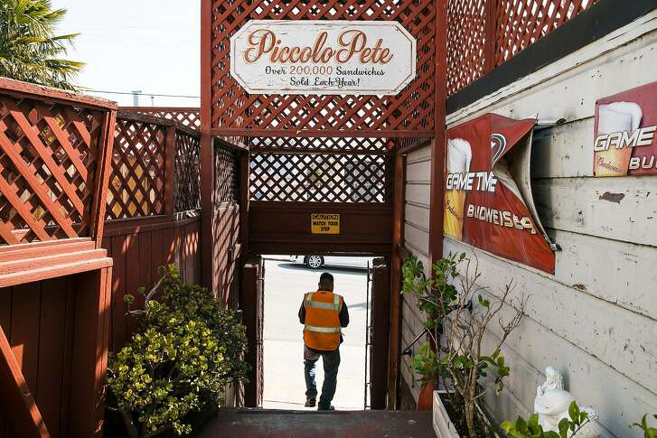 A customer walks out with his order at Piccolo Pete in San Francisco, Calif. Tuesday, October 10, 2017.