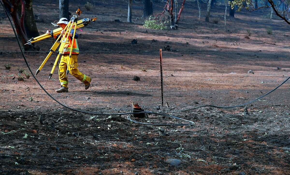 A partially burned power line on the ground as investigators searched for the cause of the Atlas fire east of Santa Rosa, Ca. as seen on Tuesday October 17, 2017.