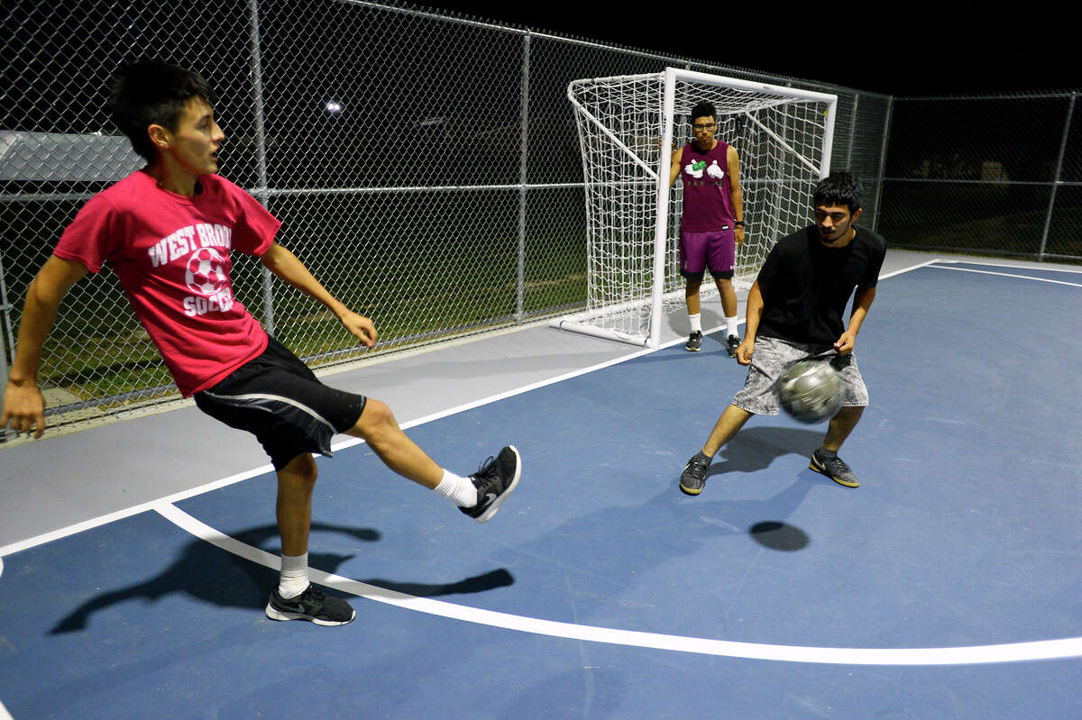 Jesse Rodriguez passes the ball to a teammate while playing at the new futsal court in Central Park on Thursday night. Photo taken Thursday 10/19/17 Ryan Pelham/The Enterprise