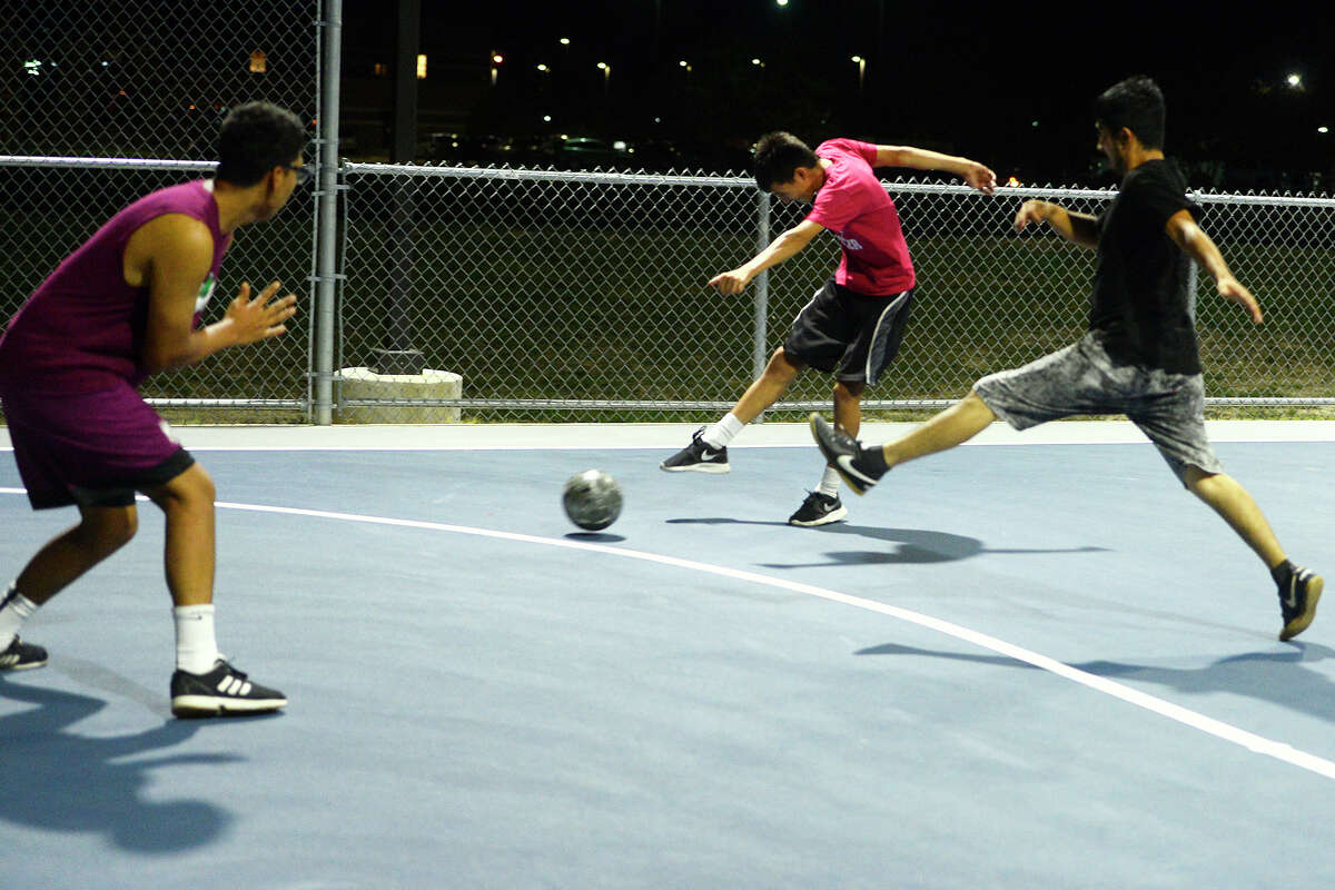 Jesse Rodriguez takes a shot while playing at the new futsal court in Central Park on Thursday night. Photo taken Thursday 10/19/17 Ryan Pelham/The Enterprise
