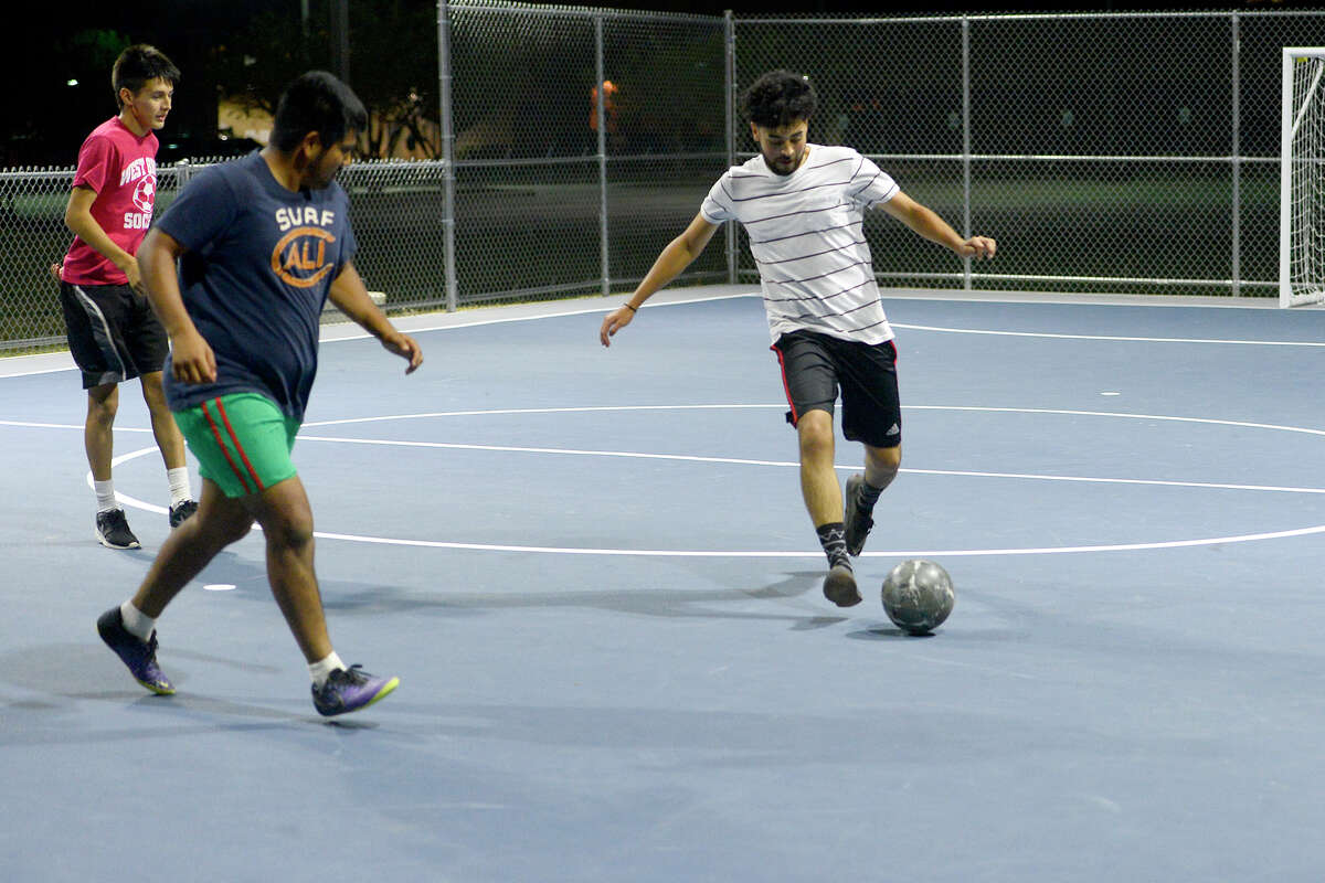Andres Castillo takes a shot while playing at the new futsal court in Central Park on Thursday night. Photo taken Thursday 10/19/17 Ryan Pelham/The Enterprise