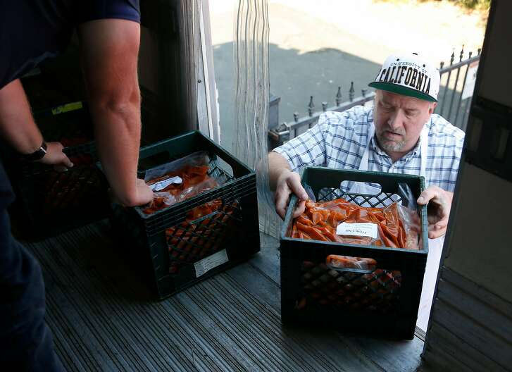 Burt Callis unloads meals donated by Facebook to the Salvation Army kitchen in Napa, Calif. on Wednesday Oct. 18, 2017. Callis is a graduate of the Salvation Army's culinary program. Facebook is stepping in with donations for the Wine Country Fires with a delivery of more than 7,000 meals to the Salvation Army to help feed evacuees and first responders.
