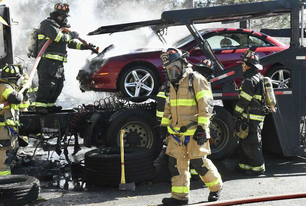 A car carrier went up in smoke and expensive sports cars were ruined by fire in Colonie, NY, on Friday, Oct. 20, 2017. (Skip Dickstein /Times Union)
