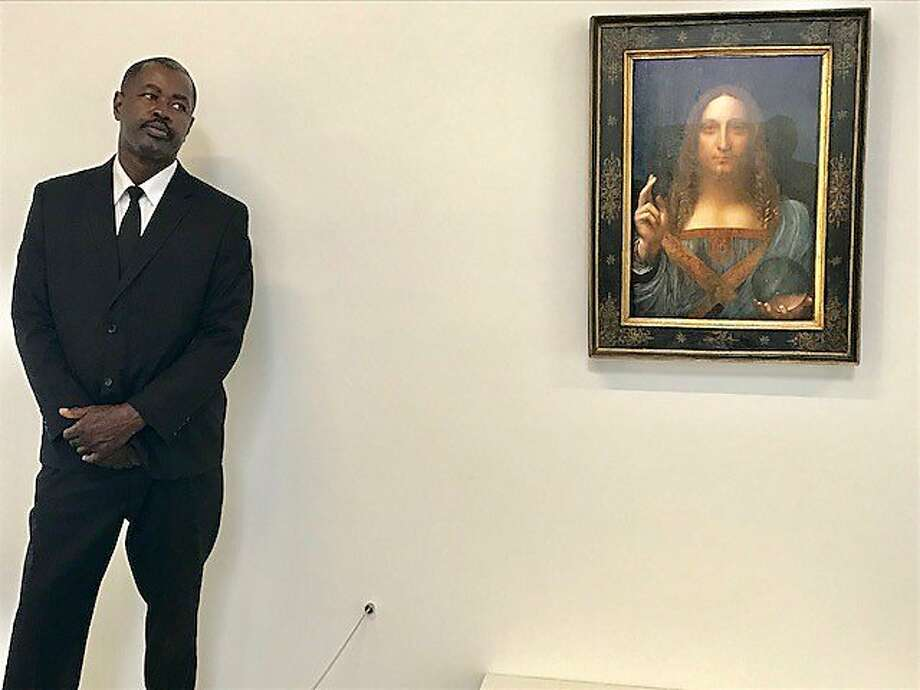 Stanley Lewis stands guard over the da Vinci. Photo: Leah Garchik, San Francisco Chronicle