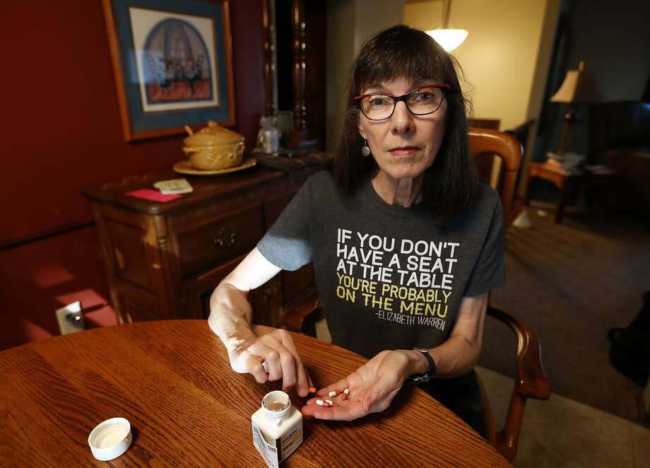 Gail Orcutt counts pills at her home in Pleasant Hill, Iowa. She doesn't know what her insurance costs will be in 2018. Photo: Charlie Neibergall, Associated Press