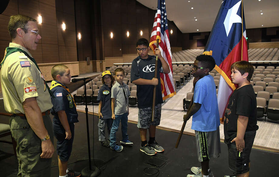 Robert Price, from left, Cub Scout Commissioner for the Phoenix District, pumps up Benjamin Reichart, 7, a Lemm Elem. LES 2nd grader, Elijah Woodard (LES 2nd grader), Dominic Vultaggio (LES 2nd grader), 7, Hunter Martin, 10, a Lemm Elementary 5th grader, Chase Sims, 9, a LES 4th grader, and Keane Porter, 10, a LES 4th grader, all members of Cub Scout Pack #1173, after a practice session of the posting of the colors by the scouts for the opening ceremony of the Klein Cain High School dedication in the school auditorium on Oct.18, 2017. (Photo by Jerry Baker/Freelance) Photo: Jerry Baker, Freelance / Freelance