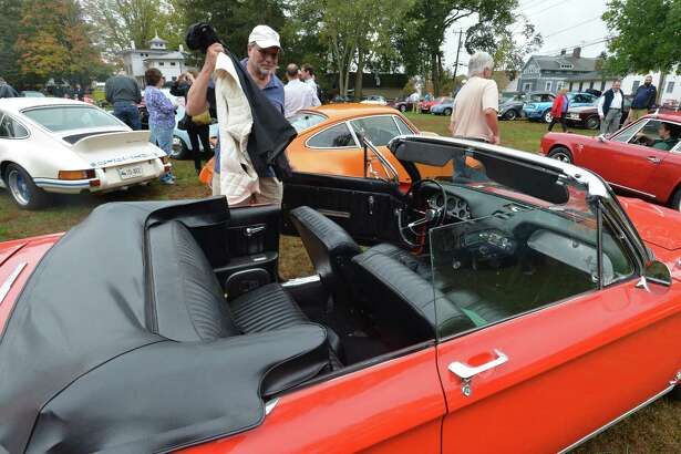 Fairfield's Kent Bain was able to dodge the raindrops in his rare turbocharged convertible 1964 Corvair during the 3rd Annual Aircooled Car Show, organized by the Small Car Company.org to benefit Homes with Hope charity, on Oct. 15 in Westport.