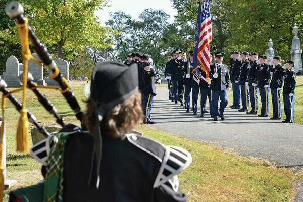 Piper Michele Lyons Polito, left, plays as a NY Army National Guard Color Guard takes up their position during a gravesite ceremony for Chester A.Arthur, our 21st president, at Albany Rural Cemetery on the anniversary of his birth Thursday Oct. 5, 2017 in Menands, NY.  (John Carl D'Annibale / Times Union)