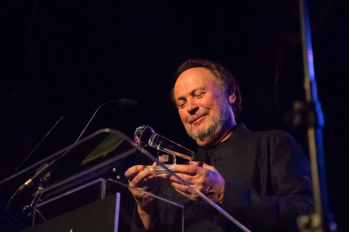 Billy Crystal receives the first annual Robin Williams Legacy of Laughter Award from the group Bring Change to Mind during its fundraiser at Bimbo's 365 Club, hosted by Glenn Close, with Idina Menzel, Wayne Brady on Friday, Oct. 20, 2017 in San Francisco, Calif.