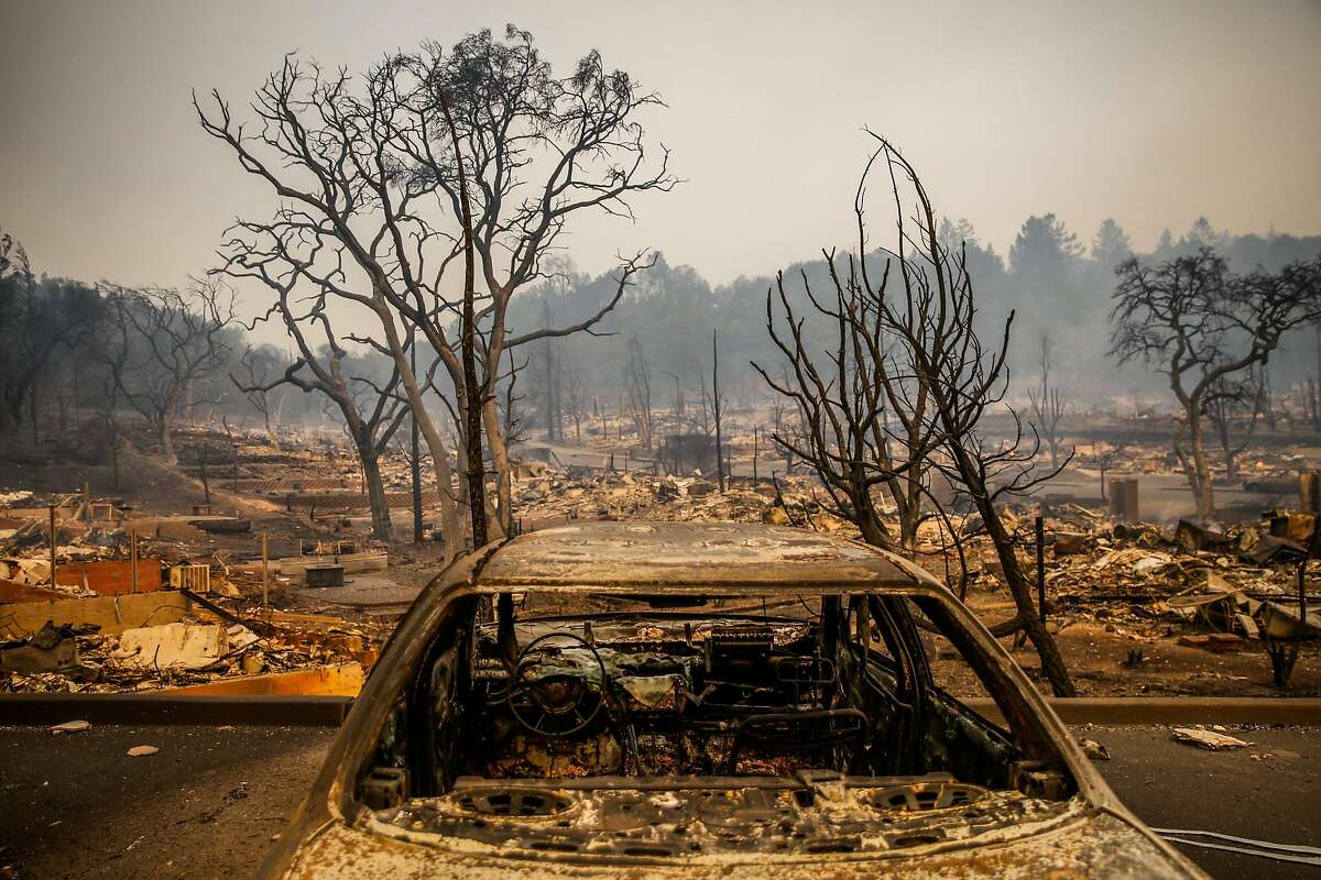 An incinerated car sits in the Fountaingrove neighborhood after being destroyed by the Tubbs fire in Santa Rosa, Calif., on Monday, Oct. 9, 2017.