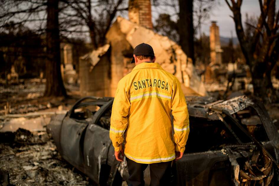 Santa Rosa Assistant Fire Marshall Paul Lowenthal walks through his Oxford Ct. residence, which burned during the Tubbs fire, on Thursday, Oct. 12, 2017, in Santa Rosa.