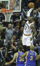 Cleveland Cavaliers' LeBron James goes up for a dunk in the second quarter during Game 4 of the 2017 NBA Finals at Quicken Loans Arena in Cleveland, Ohio