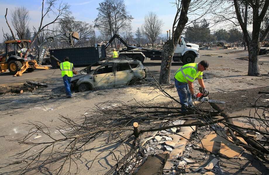 Public Works crews from the city of Santa Rosa clear debris from the streets in the Coffey Park neighborhood, a week after the start of the massive fires in Santa Rosa. Photo: Michael Macor, The Chronicle