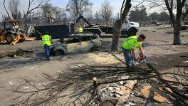 Public works crews from the city of Santa Rosa clear debris from the streets in the Coffey Park neighborhood, a week after the start of the massive fires in Santa Rosa, Ca. as seen on Monday October 16, 2017.