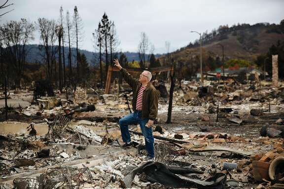 Brian Fies points to where the second floor of his house once was at his home in Santa Rosa, Calif. Thursday, October 19, 2017.
