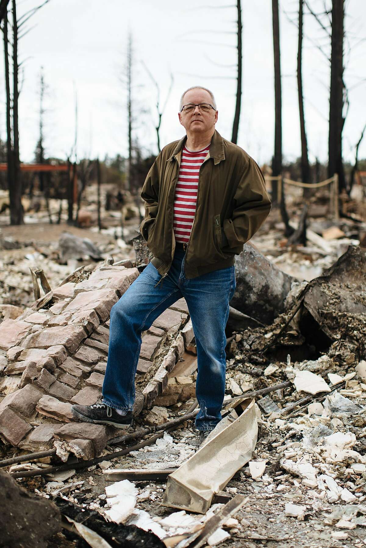 Brian Fies stands where his front door once was at his home in Santa Rosa, Calif. Thursday, October 19, 2017.