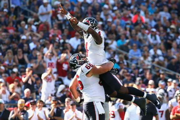 DeShaun Watson #4 celebrates with Nick Martin #66 of the Houston Texans after a touchdown during the third quarter of a game against the New England Patriots at Gillette Stadium on September 24, 2017 in Foxboro, Massachusetts.  (Photo by Jim Rogash/Getty Images)
