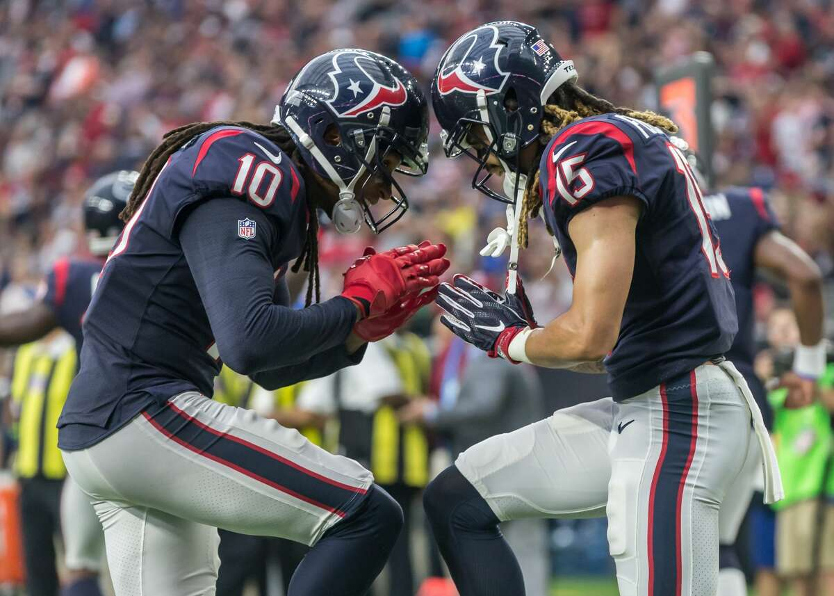 HOUSTON TEXANS Houston Texans wide receiver DeAndre Hopkins (10) and Houston Texans wide receiver Will Fuller (15) celebrate a touchdown during the NFL game between the Tennessee Titans and Houston Texans on October 1, 2017 at NRG Stadium in Houston, Texas.