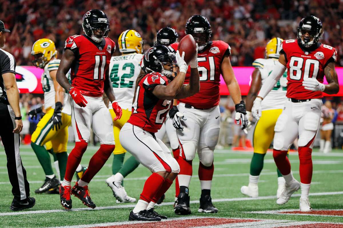 ATLANTA FALCONS Devonta Freeman #24 of the Atlanta Falcons celebrates after scoring a 1-yard rushing touchdown during the first quarter against the Green Bay Packers at Mercedes-Benz Stadium on September 17, 2017 in Atlanta, Georgia.
