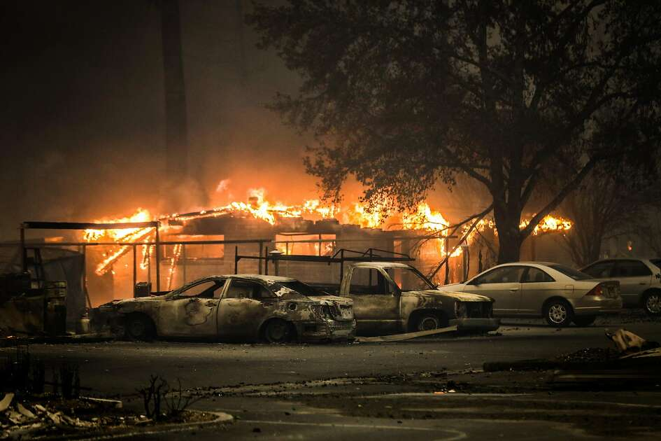 A laundromat burns at the Journey's End mobile home park during the Tubbs fire in Santa Rosa, Calif., on Monday, Oct. 9, 2017.