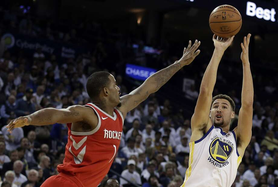 Golden State Warriors' Klay Thompson, right, shoots against Houston Rockets' Trevor Ariza during the second half of an NBA basketball game Tuesday, Oct. 17, 2017, in Oakland, Calif. The Rockets won 122-121. (AP Photo/Ben Margot) Photo: Ben Margot, Associated Press