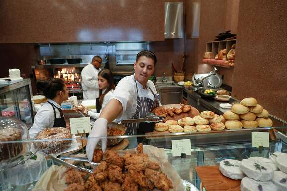 Chef Mouhssine Benhamacht restocks the fried chicken at Meraki Market on Thursday, Oct. 19, 2017 in San Francisco, Calif.