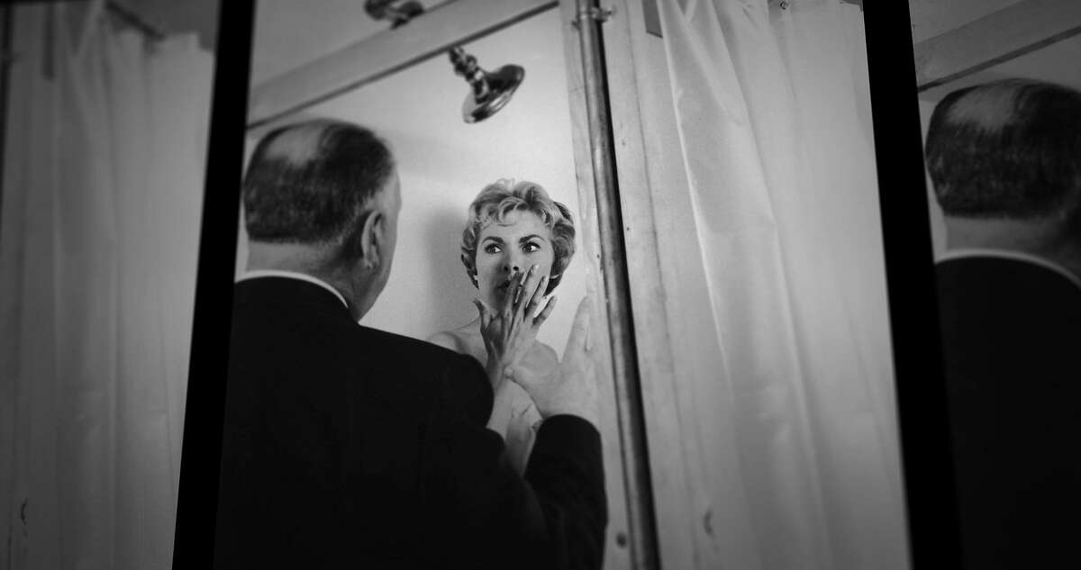 """Alfred Hitchcock and Janet Leigh on the set of """"Psycho,"""" an image from """"78/52,"""" a documentary about the film's shower scene."""