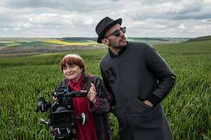 """Film director Agnes Varda and photographer and muralist JR (cq) in the documentary """"Faces Places,"""""""