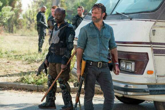 "In this image released by AMC, Lennie James portrays Morgan Jones, left, and Andrew Lincoln portrays Rick Grimes in a scene from ""The Walking Dead."" The eighth season premieres on Oct. 22. (Gene Page/AMC via AP)"