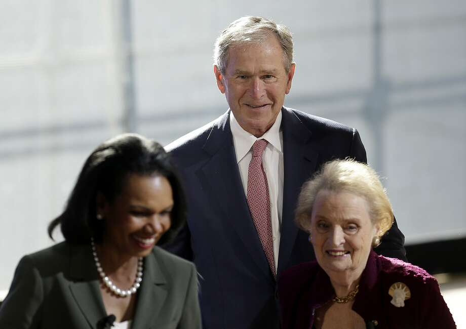 Former U.S. President George W. Bush greets former U.S. Secretary of State  Condoleezza Rice, left, and Madeleine Albright, right, after they participated in a panel discussion at a forum sponsored by the George W. Bush Institute in New York, Thursday, Oct. 19, 2017. (AP Photo/Seth Wenig) Photo: Seth Wenig, Associated Press