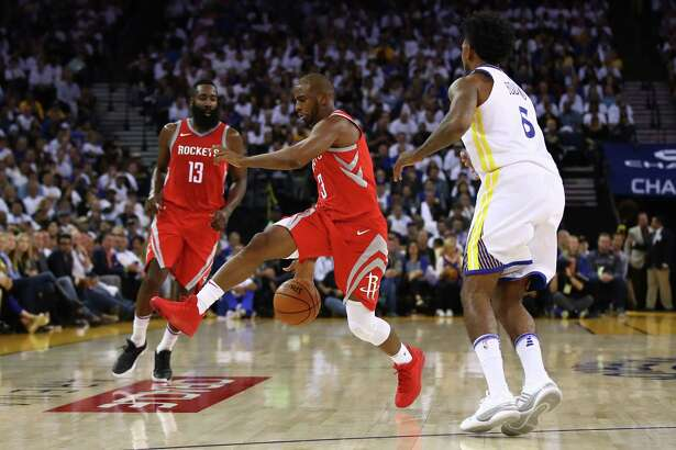 Rockets guard Chris Paul, center, played 33 minutes in the season-opening win over the Warriors, scoring four points on 4 for 9 shooting. He sat the following night in Sacramento with a bruised knee and will be out for an unknown period.