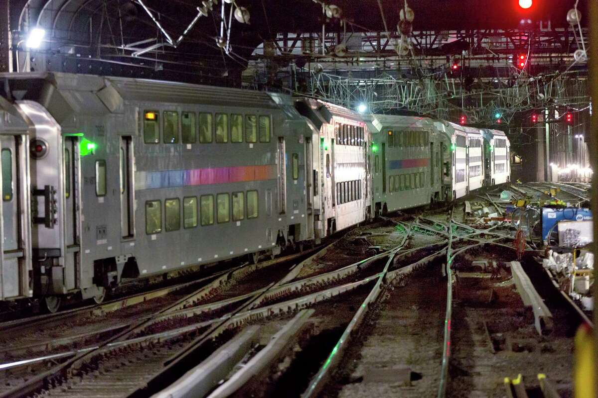 FILE - In this July 25, 2017 file photo, a New Jersey Transit train traverses the tracks in New York's Penn Station where a two-month repair project was underway by Amtrak. The Summer of Hell is ending and New York commuters say it didn't live up to the hype. Gov. Andrew Cuomo predicted infernal transit woes when Amtrak announced it would curtail service while performing extensive track repair work at Penn Station. Amtrak says the work has been completed and normal service will resume Tuesday, Sept. 5. (AP Photo/Richard Drew) ORG XMIT: NY108