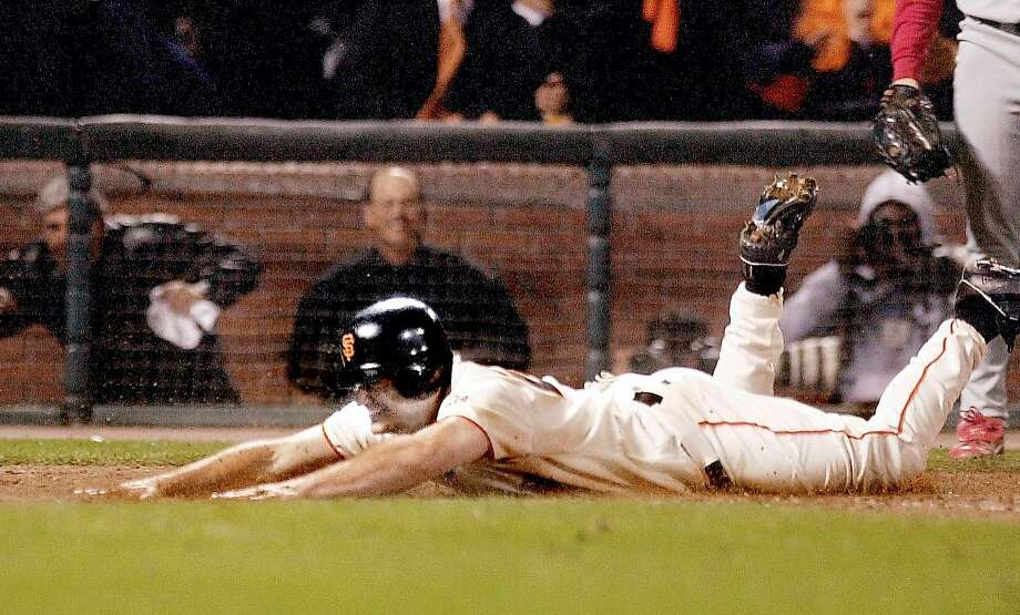 GIANTSA-C-14OCT02-SP-DB Giants David Bell slides home scoring the winning run in their 2-1 victory to give the Giants the National League Championship at Pac Bell Park in San Francisco, Ca. October 14, 2002.  Darryl Bush/San Francisco Chronicle Photo: Darryl Bush, Sfc