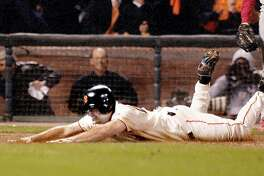 GIANTSA-C-14OCT02-SP-DB Giants David Bell slides home scoring the winning run in their 2-1 victory to give the Giants the National League Championship at Pac Bell Park in San Francisco, Ca. October 14, 2002.  Darryl Bush/San Francisco Chronicle