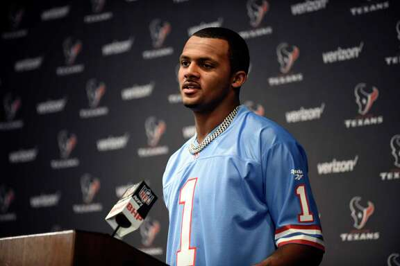 Houston Texans quarterback Deshaun Watson, wearing a Warren Moon Houston Oilers jersey, responds to a question during a news conference after after an NFL football game against the Cleveland Browns on Sunday, Oct. 15, 2017, in Houston. (AP Photo/Eric Christian Smith)