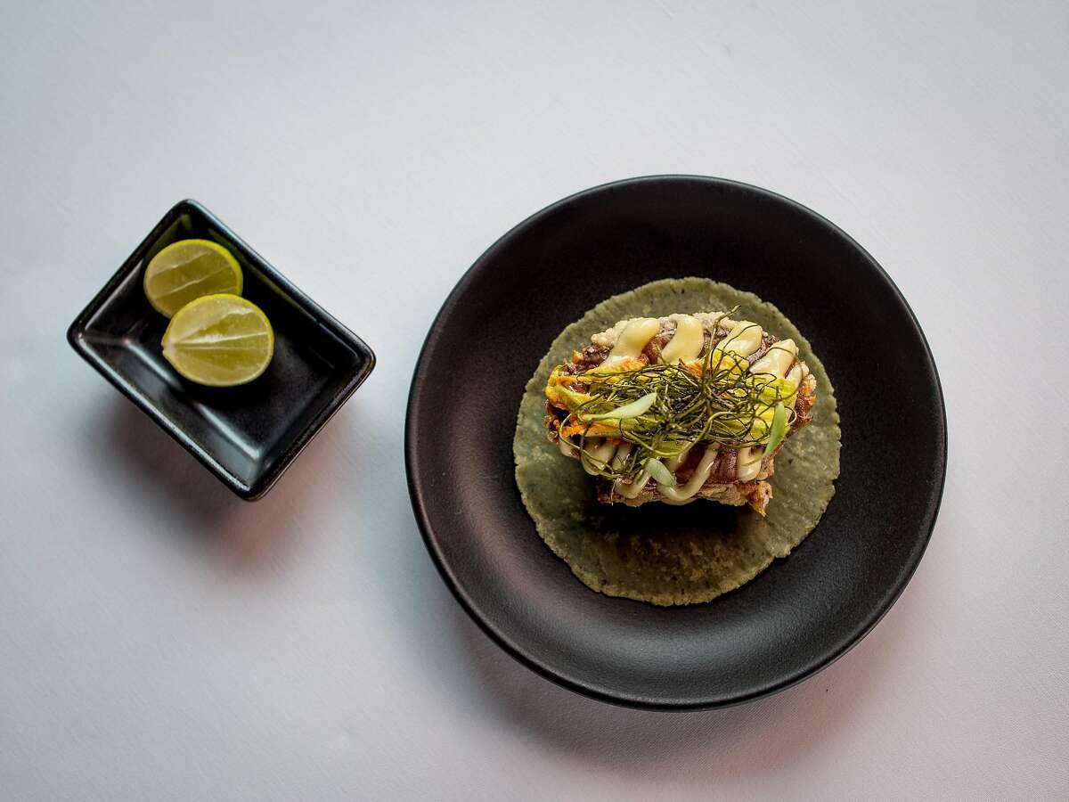 A crab taco is seen at Californios in 2017. The restaurant's current menu features a crispy fish taco on a sourdough tortilla.