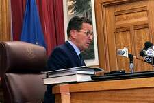 Gov. Dannel P. Malloy speaking with reporters in his Capitol office on Friday Oct. 20, 2017, said he called off a planned weekend meeting with Democratic leaders because the tentative budget is not yet a document he can review.