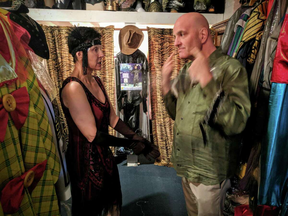 Belinda Shepard is outfitted by Glenn Beyus, Sophia's costume manager, in an authentic vintage flapper costume this week.