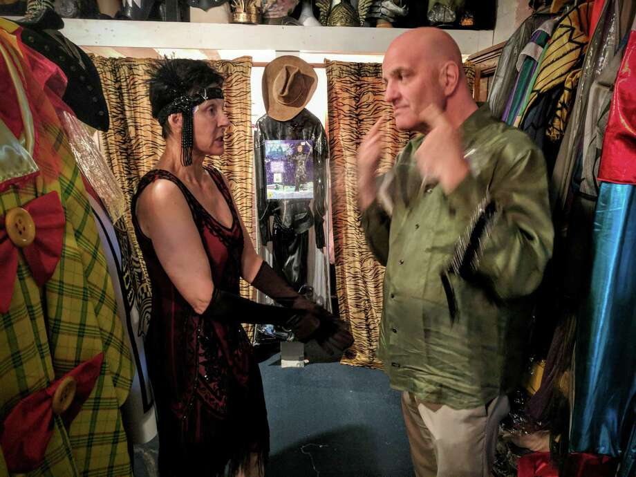 Belinda Shepard is outfitted by Glenn Beyus, Sophia's costume manager, in an authentic vintage flapper costume this week. Photo: Jennifer Turiano /