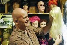 Store employee Glenn Beyus combs out a costume wig at Sophia's costume store in Greenwich, Conn. Wednesday, Oct. 18, 2017. As Halloween approaches, Sophia's is one of the go-to places in Greenwich to rent or buy costumes and accessories.