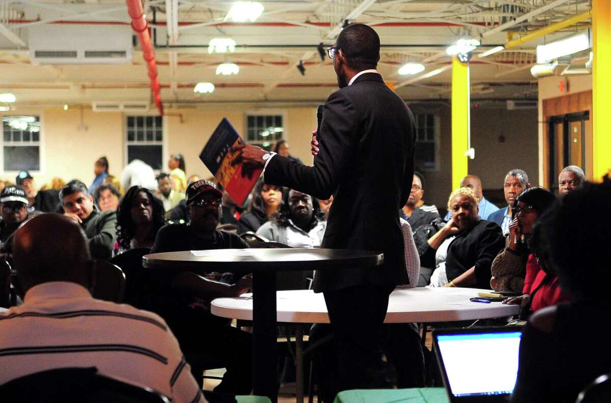MGM executive Uri Clinton answers resident's questions about their proposed casino during a meeting with the community group East End NRZ in Bridgeport, Conn., on Wednesday Oct. 18, 2017.