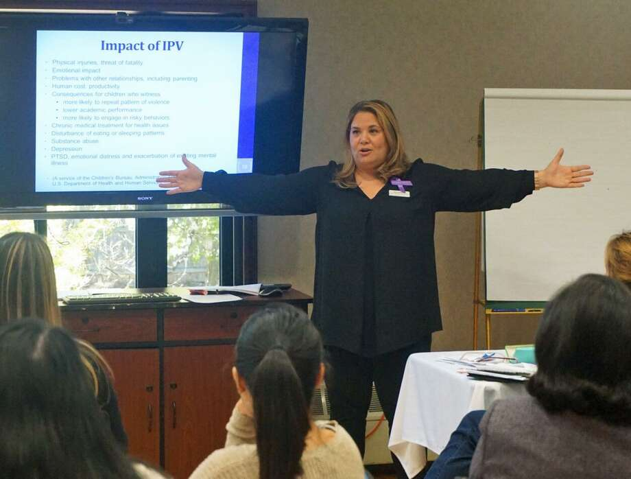 Meredith Gold, director of Domestic Abuse Services at the YWCA Greenwich, explains what men can do to reduce intimate partner violence in a workshop Friday. Photo: Emilie Munson