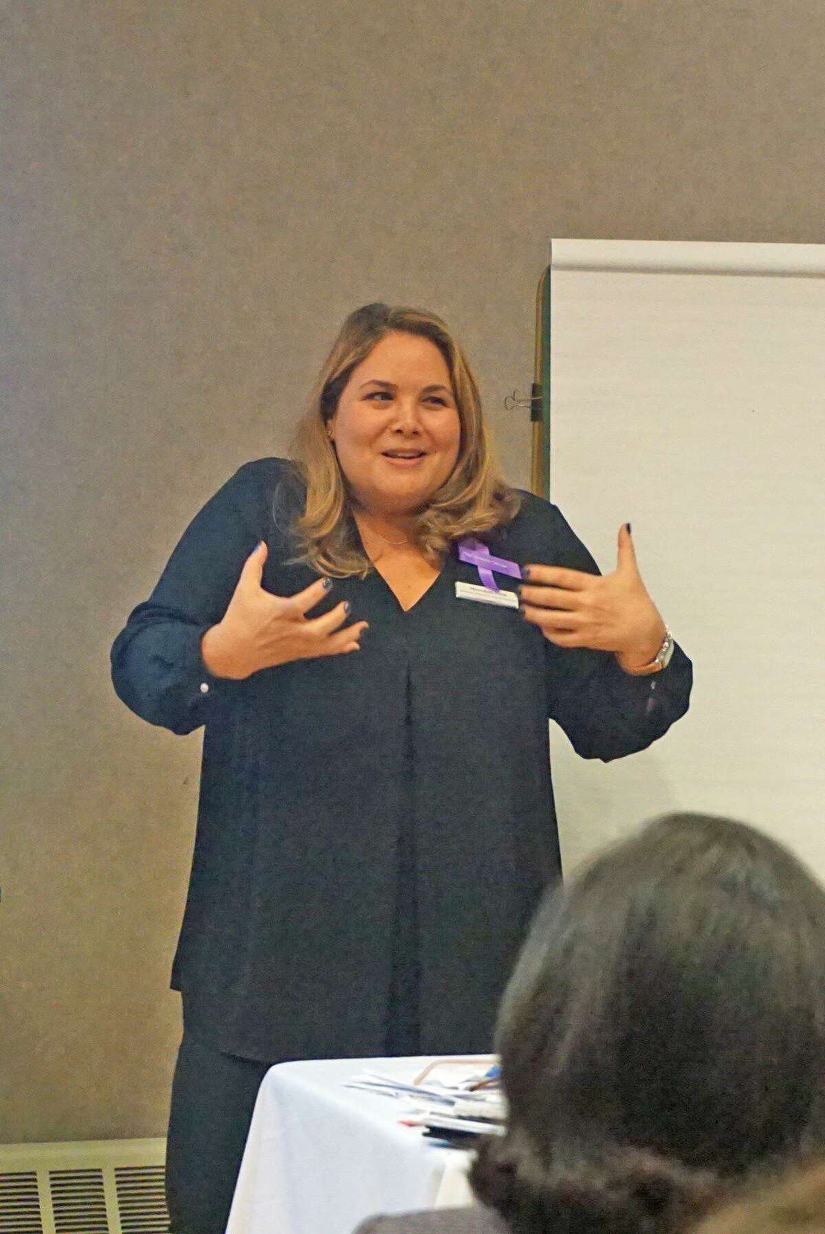 Meredith Gold, director of Domestic Abuse Services at the YWCA Greenwich, explains the impacts of intimate partner violence on victims and their families in a workshop Friday.