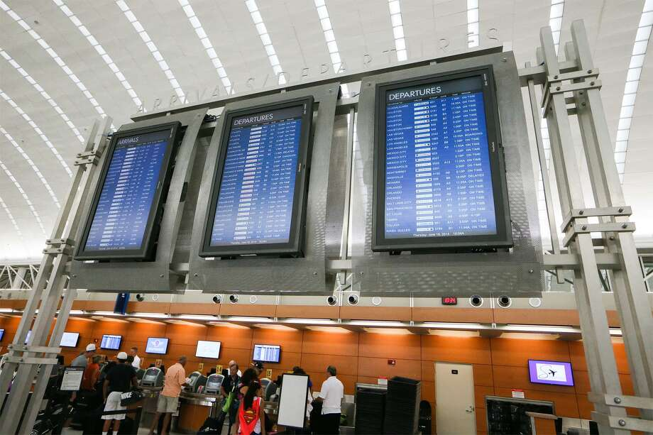 Passengers wait in line at Terminal A at the San Antonio International Airport in 2014. Claiming that the airport is keeping the city from flourishing deflects attention from the lack of college-educated residents here. It would be easier to just build a new airport than to raise local college graduation rates. Photo: Express-News File Photo / EN Communities 2014