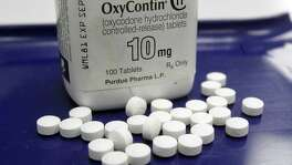 OxyContin pills at a pharmacy in Montpelier, Vt., on Sept. 18. The city of Everett, Wash., has sued makers of the prescription opioid OxyContin. The lawsuit contends that the pharmaceutical company knew its prescription painkiller was being funneled into the black market, helping create the opioid epidemic.