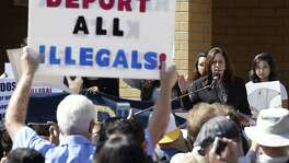 Pro-Trump supporters interrupt Sen. Kamala Harris, D-Calif., at the University of California, Irvine this month. Forty percent of the Republican primary voters who gave the nomination to Donald Trump were anti-immigrant.