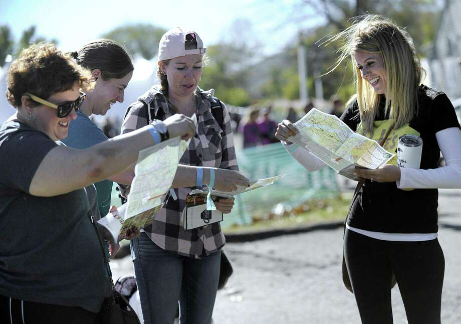 New friends from left, Adina Judovin, of New Jersey, Megan Tokarski, of Southbury, Denise Kelly, of Long Island and Erin Slockbower of California, look over maps that guide visiters to the different events in downtown Kent, Friday, Oct. 20, 2017, the first day of the three-day Gilmore Girls Fan Fest in Kent. Photo: Carol Kaliff / Hearst Connecticut Media / The News-Times
